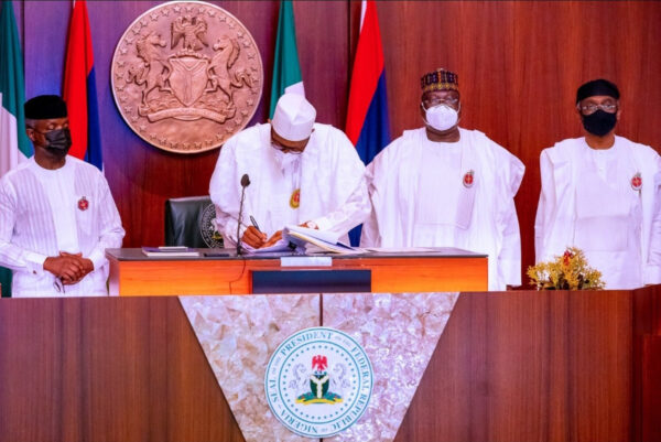 President Buhari signs 2021 budget into law photos