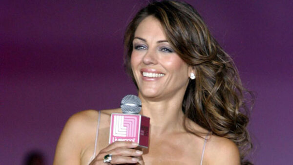 Elizabeth Hurley Shares Pics In White Lace Lingerie From 'The Royals'