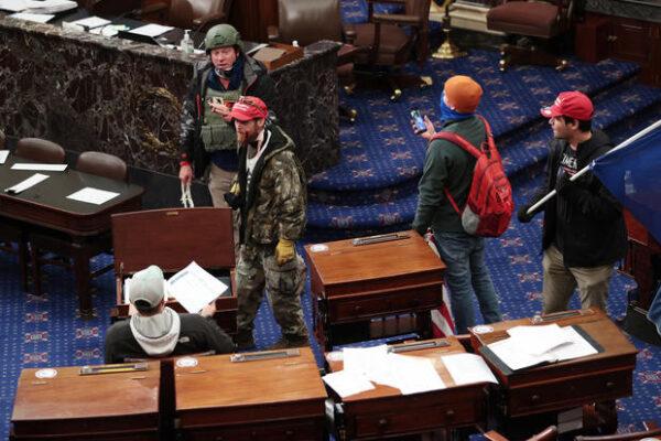 2 men seen in viral photos carrying zip ties during US Capitol riot have been arrested1