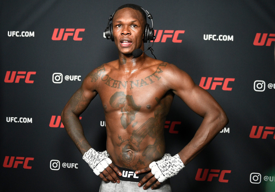 Israel Adesanya dropped by BMW after 'rape comments to rival Kevin Holland