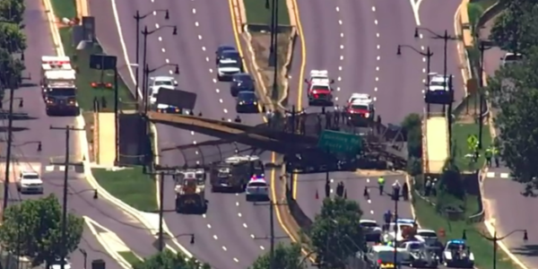 5 people hospitalized after pedestrian bridge collapses onto DC highway photos