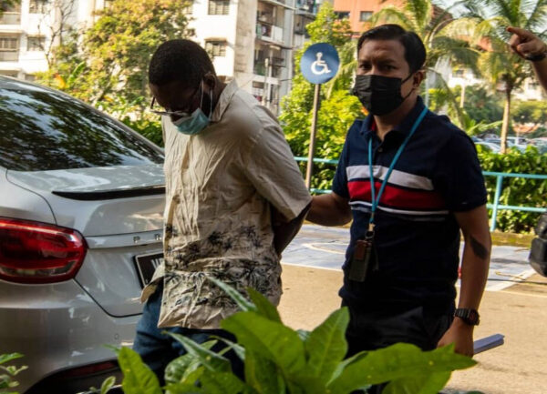 Nigerian man and his Malaysian wife charged with illegal transfer of money belonging to another person in Kula Lumpur