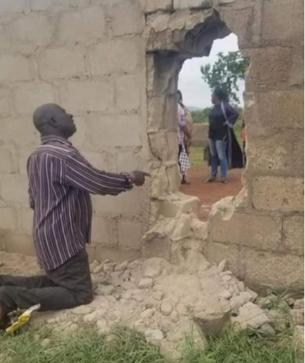 Father of a kidnapped student praying at the school for safe return of his child