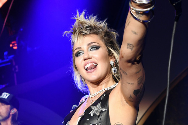 Miley Cyrus rocks out with fauxhawk and tiny miniskirt in Las Vegas